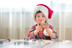 Little boy helping at kitchen with baking cookies Royalty Free Stock Photo