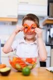Little boy helping at kitchen Stock Photos