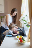 The little boy is helping mom in the kitchen Stock Photography