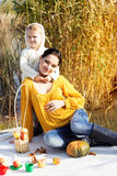 Little boy with her mother on the autumn lake Stock Images