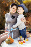 Little boy with her mother on the autumn lake Royalty Free Stock Image