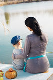 Little boy with her mother on the autumn lake Royalty Free Stock Images