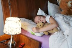 Little boy  in bed Stock Image
