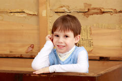 The little boy hid in an old chest. Cute little boy hiding in an old trunk royalty free stock photography