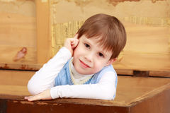The little boy hid in an old chest. Royalty Free Stock Photography