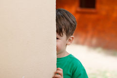 Little boy hide and seek royalty free stock photos