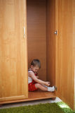 Little boy hiding in closet Royalty Free Stock Images