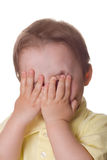 Little boy hiding his face Royalty Free Stock Photography