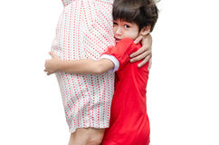 Little boy is hiding  his mother with scary Stock Photos