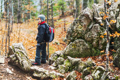 Little boy hiking Stock Images