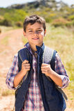 Little boy hiking in the mountains Stock Photo