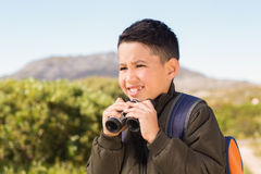 Little boy hiking in the mountains Stock Images
