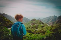 Little boy hiking travel in mountains looking at view. Family travel royalty free stock images