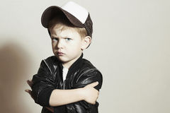 Little boy.Hip-Hop Style. fashion children.Young Rapper.Serious Child. Little boy.Hip-Hop Style. fashion children.handsome.i n Tracker Hat. Young Rapper. Serious Stock Image