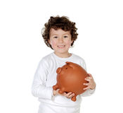 Little boy with his a big piggybank Royalty Free Stock Images