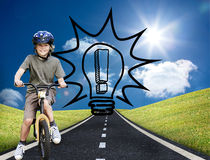 Little boy with his bike in a park Royalty Free Stock Photography