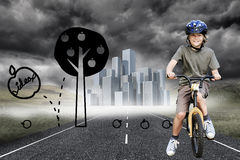 Little boy with his bike in a park Royalty Free Stock Photo