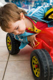 Little boy and his bobby-car Royalty Free Stock Images