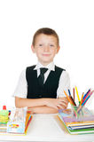 Little boy at his desk with an album for drawing, pencils and books on white background Stock Photography