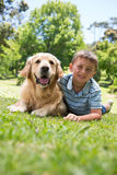 Little boy with his dog in the park Royalty Free Stock Photo