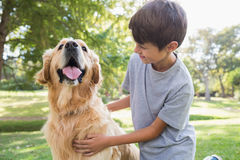 Little boy with his dog in the park Royalty Free Stock Photography