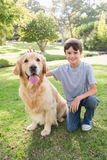 Little boy with his dog in the park Stock Photography