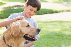 Little boy with his dog in the park Stock Photos