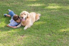 Little boy with his dog in the park Stock Images