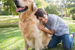 Little boy with his dog in the park Stock Photo