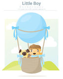 Little boy and his dog riding a hot air balloon Stock Image