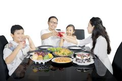 Little boy with his family enjoying lunch Royalty Free Stock Photos
