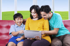 Little boy and his family using tablet Stock Photo