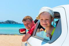 Little boy and his father in a car. On the beach Stock Photos