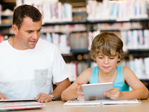 Little boy and his father with laptop Royalty Free Stock Photo