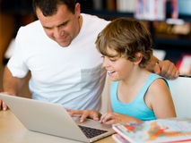 Little boy and his father with laptop Royalty Free Stock Photography