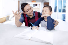 Little boy and his father learn to calculate Stock Photography