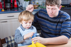 Little boy and his father making inhalation with nebuliser Royalty Free Stock Photos