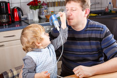 Little boy and his father making inhalation Royalty Free Stock Photography