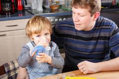Little boy and his father making inhalation with nebuliser Royalty Free Stock Photography