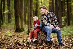 Little boy with his father during stroll in the forest Stock Images