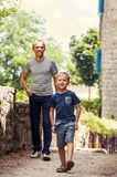 Little boy with his father walk together Stock Images