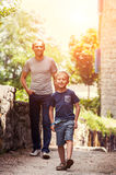 Little boy with his father walk together Royalty Free Stock Photography