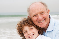 Little boy with his grand father. Happy grand father with grandson on beach stock photos