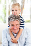 Little boy with his grandfather Stock Photo