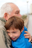 Little boy with his grandfather. Grandfather hugging his grandson outdoors Stock Image