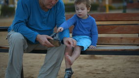 Little boy and his grandfather Stock Photography