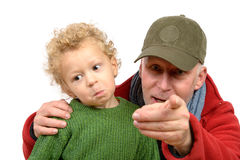 A little boy and his grandfather Royalty Free Stock Images