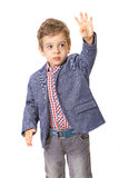 Little boy with with his hand lifted up Stock Photo