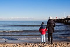 Little boy with his mother at the beach Stock Images