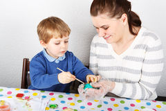 Little boy and his mother being happy about selfmade Easter eggs Royalty Free Stock Image